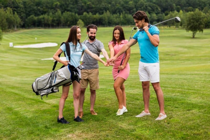 Golf Enthusiasts Team Holding Hands