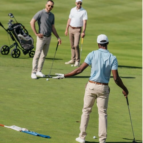 Golfer playing with friends in golf course